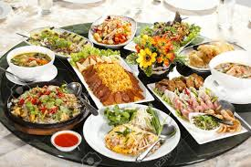table full of food mixed food full rounded table of chinese thai food duck and sauce
