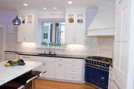 black kitchen cabinets with white subway tile backsplash white kitchen with a blue kitchen stove in wilmington delaware