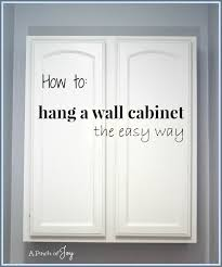 how to install wall cabinets how to hang a wall cabinet the easy way