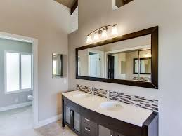 master suite with a stand alone vanity with granite countertop and