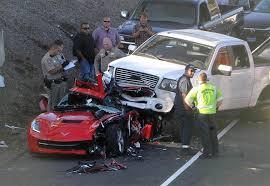 corvette crash truck lands on top of a corvette stingray in
