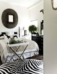 decor black and white rug with unique wall decor and plants over