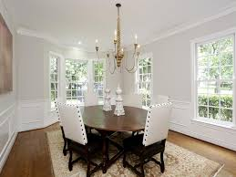 spacious dining room with hardwood floors high ceilings bay