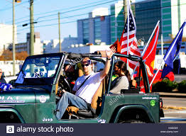 Va Flag An American Patriot Drives A Decorated Jeep Down The Street During