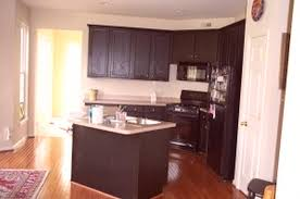 corner dark brown wooden kitchen cabinet with stove and white