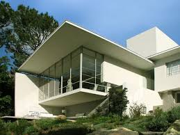 unique concrete home designs with floating balcony and glass cute statue facing large transparent glass windows above white fabric sofa also white tube corner floor concrete home designs