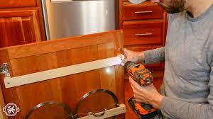 kitchen cabinet door pot and pan lid rack organizer diy pot lid holder fixthisbuildthat