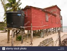Small Beach House On Stilts Caye Caulker Belize Water Catchment System On Wooden Cottage On