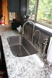 63 best granite ideas images on pinterest kitchen kitchen ideas ashen white granite slab gray cabinet google search