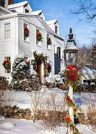 new houses being built with classic new england style christmas in a new england clapboard traditional home