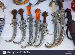 ornamental daggers for sale the souk agadir morocco stock photo