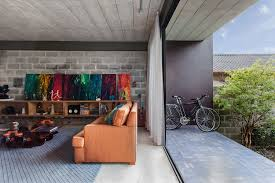 cement and concrete brazilian home is energized with bright color