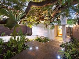 romantic backyard garden with mounted lighting for small garden