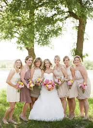 lord and dresses for weddings neutral bridesmaid dresses with bright bouquets photo by