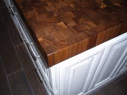 end grain walnut island wood countertop with white cabinets