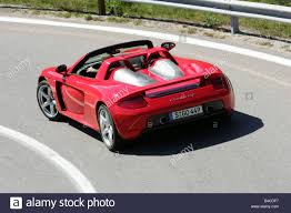 red porsche convertible car porsche carrera gt model year 2005 red convertible open