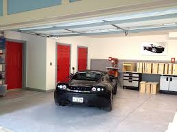 large low ceiling home car garage with concrete floor tiles and