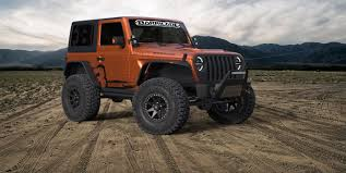 modified 4 door jeep wrangler win two modified 2018 jl wranglers jeepfan com