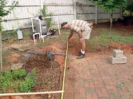 Building A Raised Patio With Retaining Wall by How To Build A Block Retaining Wall How Tos Diy