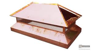 angled copper chimney cap with standing seam panels on a hip roof
