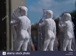 small statues of michelangelo u0027s david wrapped in clear plastic for