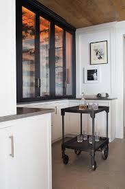 Black Bar Cabinet Black Glass Wine Cabinet With Black Wine Cart Transitional Kitchen