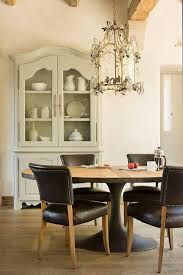 restoration hardware oval dining table french dining room features a gold lantern adorned with crystal
