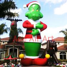 inflatable grinch pulling christmas tree out of chimney youtube