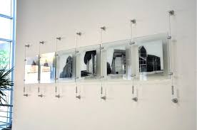 hanging pictures with wire and clips cable hanging system media art cable hanging system media art