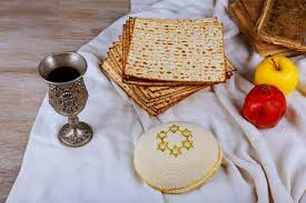 seder matzah passover concept with matzah seder plate and wine