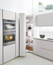 white corner kitchen pantry cabinet with pull out drawers and
