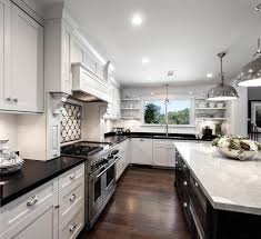 white kitchen cabinets with black countertops white kitchen cabinetry with black countertops dewils