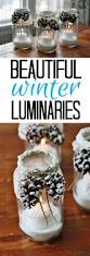 check out snowy pinecone candle jars it s so easy to make more learn how to make these gorgeous winter luminaries with fake snow and pinecones get the