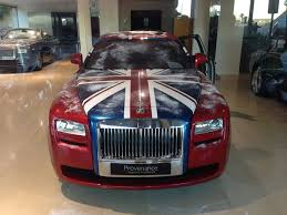 roll royce maroon rolls royce ghost with a holiday wrap by ms motors