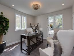capiz flush mount light dark brown desk with white wingback chairs transitional den