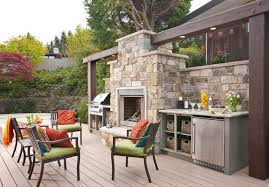outdoor kitchen design ideas with fireplace and patio chairs