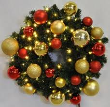5 pre lit warm white leds sequoia wreath decorated with the