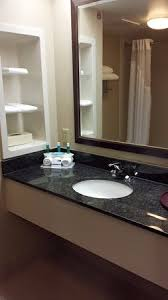 nice and clean bathroom with storage shelves picture of holiday
