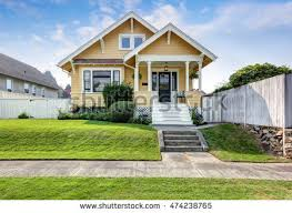 american craftsman american craftsman home yellow exterior paint stock photo 474238765