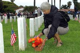 file us navy 070528 n 4658l 014 valerie gilbert lays flowers out for