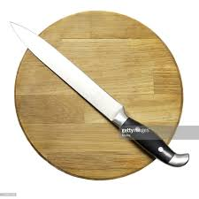 large kitchen knife on a wooden board stock photo getty images