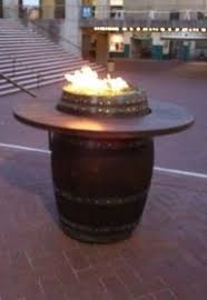 Wine Barrel Fire Pit Table by A Unique And Fun Way To Bring Warmth Out To Your Patio Or Garden