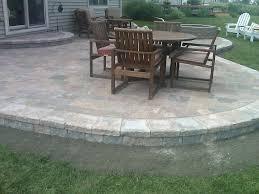 Brick Paver Patio Cost Estimator Raised Brick Paver Patio With Unilock Pisa Ii Retaining Wall And