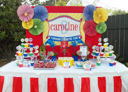 carnival birthday party and blue gingham table cloths burlap covered potted plants