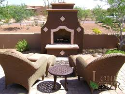 outdoor fireplace with decorative concrete trim in scottsdale