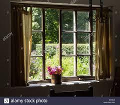 cottage garden view into a pretty country garden through a