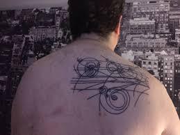 bubble chamber physics tattoo on men upper back golfian com