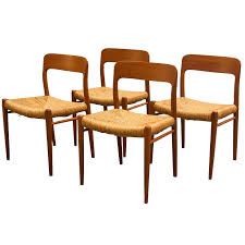 set of four niels moller model 75 teak dining chairs with rush
