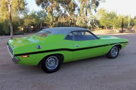 1970 dodge charger green dodge charger or challenger which would you buy