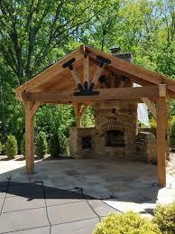 a backyard pavilion with a fireplace serves as a multi purpose